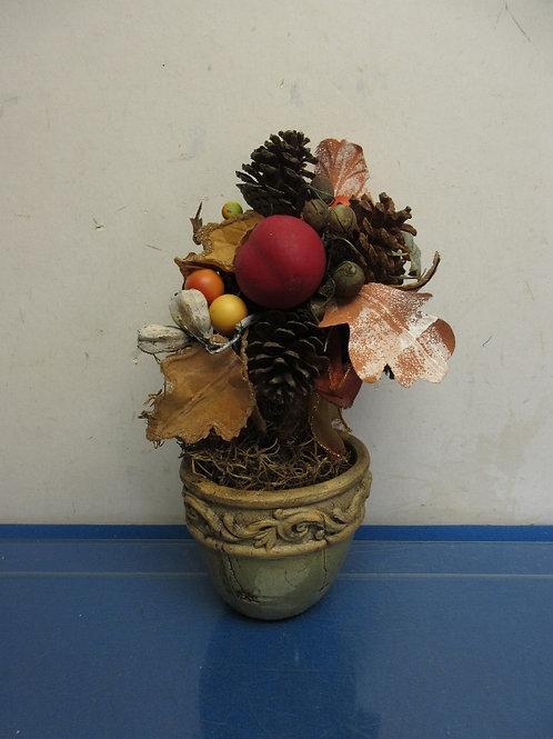 Pine cone and faux fruit arrangement in ceramic planter