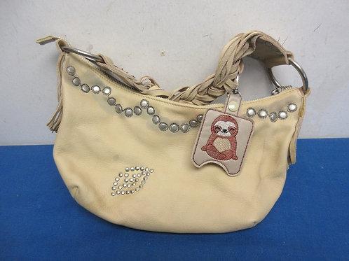 Tan leather hobo bag style purse