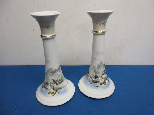 Pair of asian white porcelain candle holders with scene