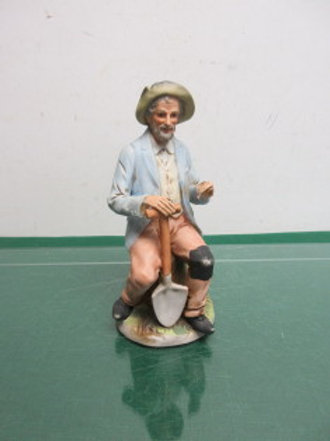 "Homco statue of man sitting with shovel 8"" high"