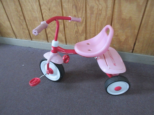 Pink radio flyer tricycle with rear storage box