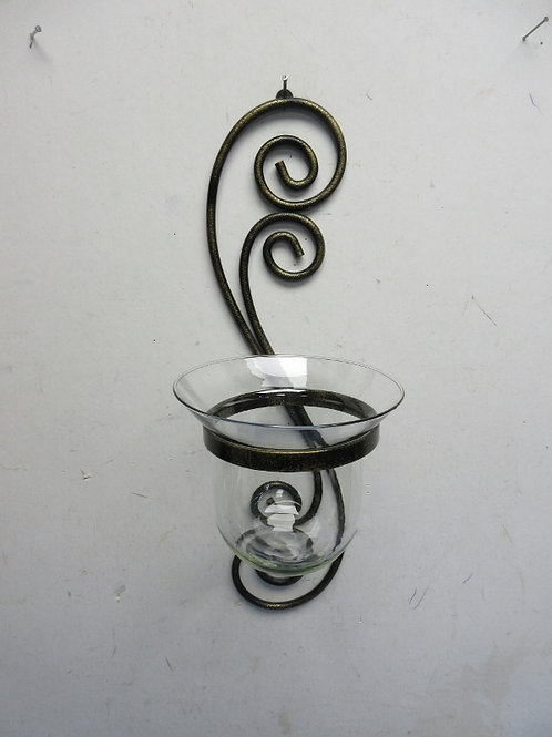 Scroll design wall hanging with glass candle holder