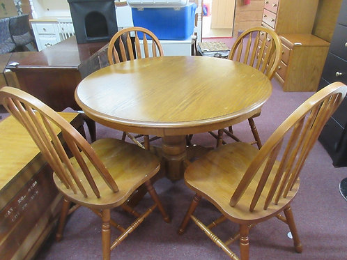 Round pedestal table with 4 slat back chairs