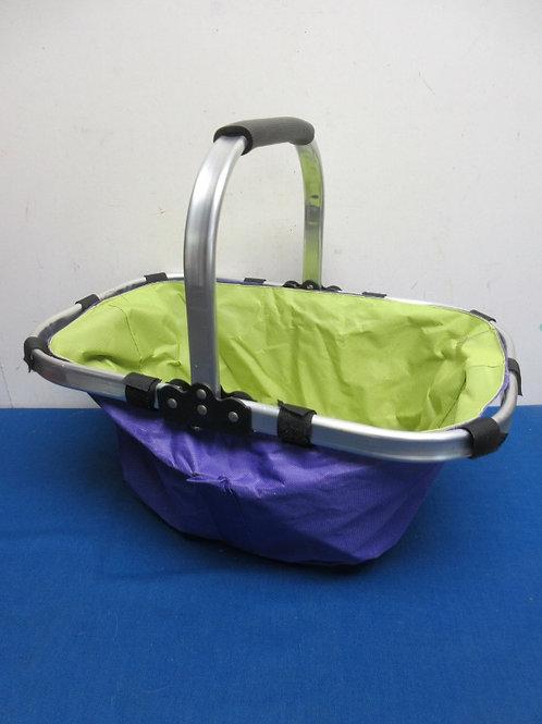 Purple and green cloth folding picnic basket