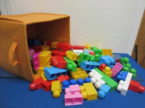 Set of over 100 mega bloks in orange bin