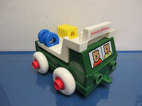 Johnson & Johnson green and white stack and dump truck