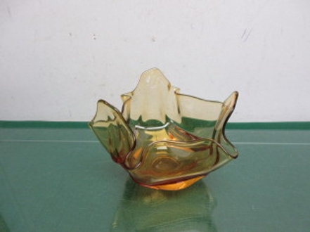 Brown glass bowl with crimped wavy edges
