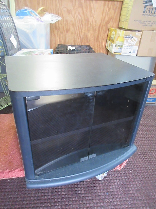 """Black TV stand with black glass doors for bottom storage, 19x23x17""""high"""