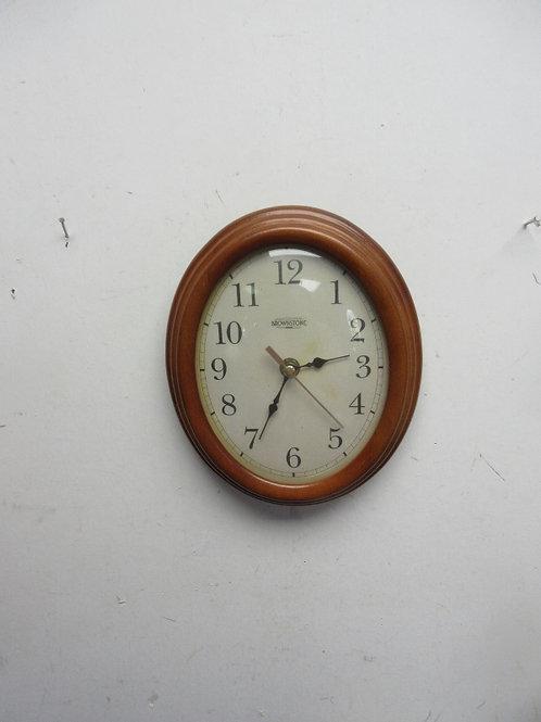 "Brownstone small oval wall clock, 7x9"""