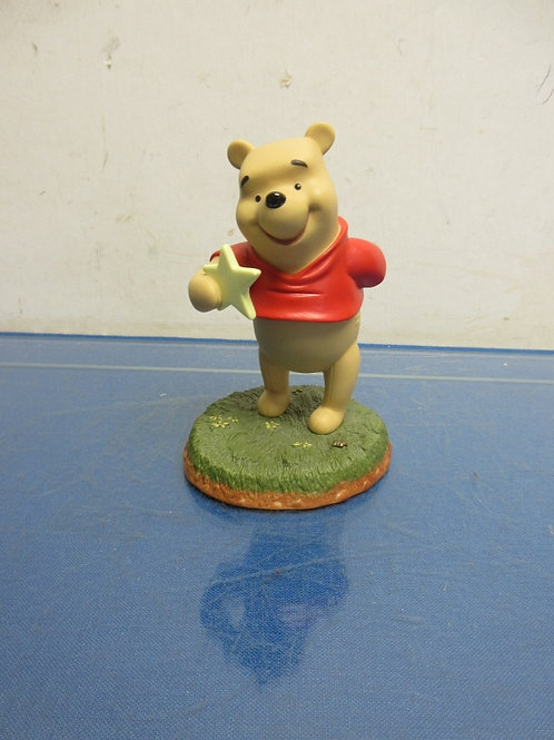 Winnie the Pooh statue with wishing star