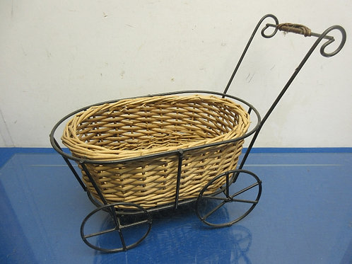 Decorative metal frame baby buggy with wicker basket insert