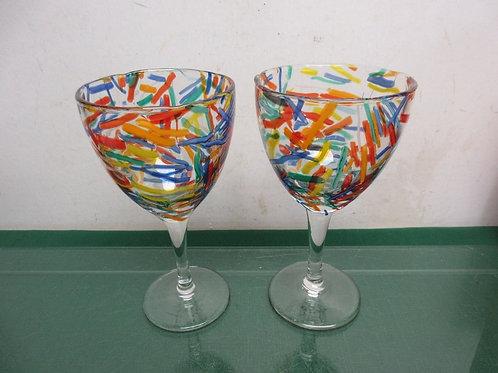 Pair of stemmed multicolored wine glasses
