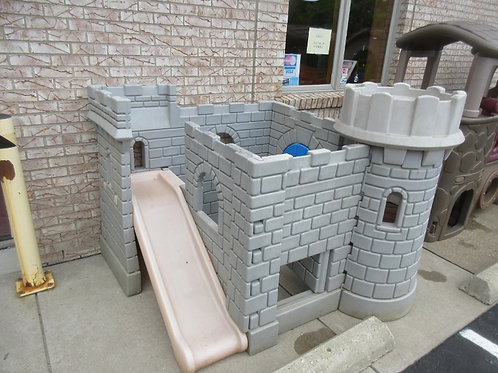 Little Tikes castle with slide and blue door