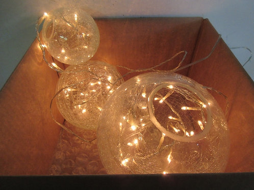 """Three glass globes (2"""",4"""",6"""" diameter) filled with twinkle lights"""