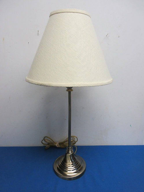 Goldtone stick lamp with ivory shade
