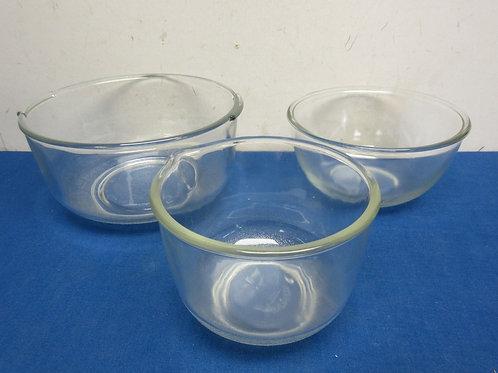 Set of 3 glass mixing bowls, graduated sizes, smallest one has a pour spout