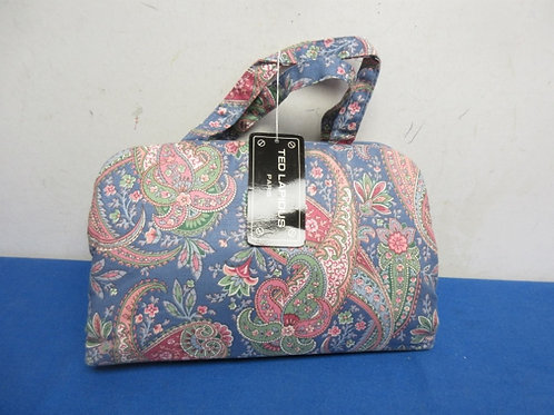 Blue paisley cosmetic travel bag with small empty bottles