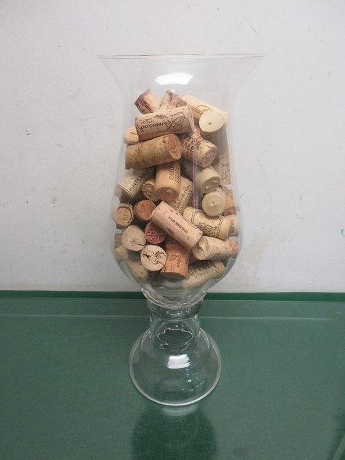 "Large glass vase filled with wine bottle corks, 14"" tall"