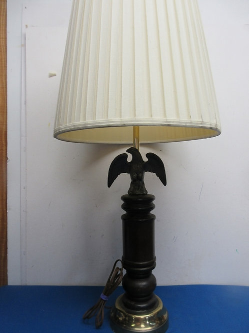 Wood base lamp with brass eagle and white pleated shade