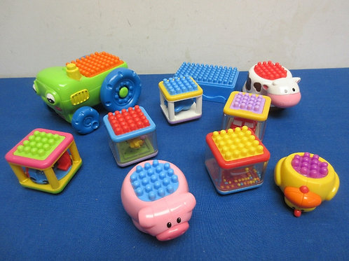 Fisher Price toddler bristle blocks, with vehicle, cow, and pig