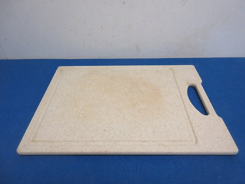 Heavy resin cutting board with juice groove around edge