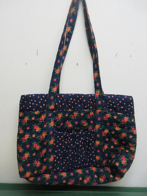 Navy blue quilted tote bag with floral design