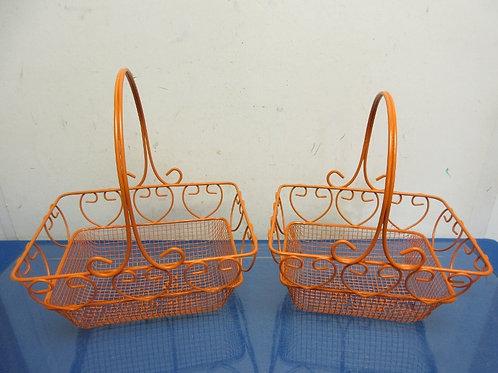Pair of orange metal rectangular baskets with handles