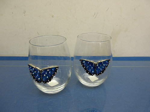 Pair of stemless wine glasses with blue bejeweled butterfly accents
