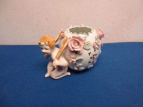 Bone china small vase - cherub holding up floral vase