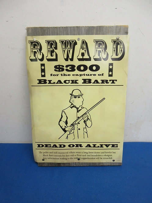 Wanted dead or alive reward poster on wood