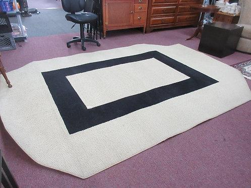 Large handmade tan and black area rug - 117x85