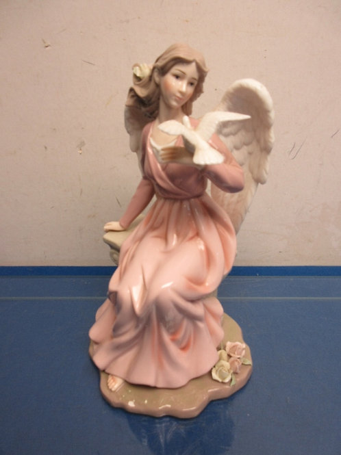 """Sitting angel in pink gown holding a dove- 11"""" high"""