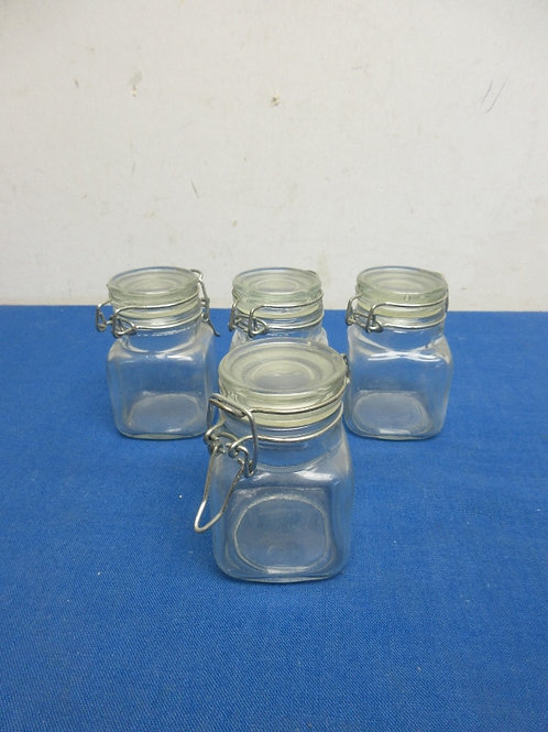 Set of 4 small locking top glass jars