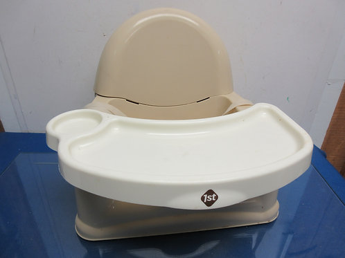 Safety First tan & ivory booster seat with a high chair tray