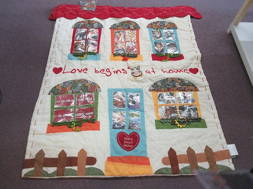"""Love begins at home quilt,wall hanging, w/24 slots for pictures 48x60"""""""