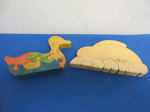 Pair of hand cut wooden puzzles, rabbit and duck