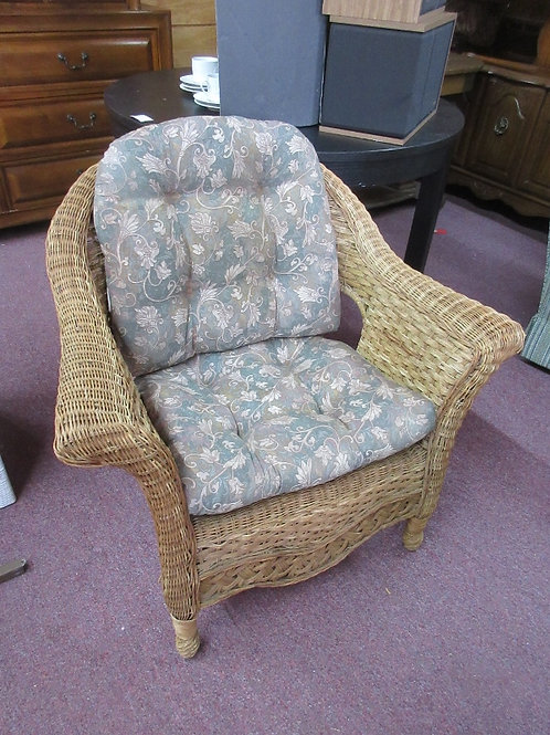 Natural wicker arm chair with floral cushions