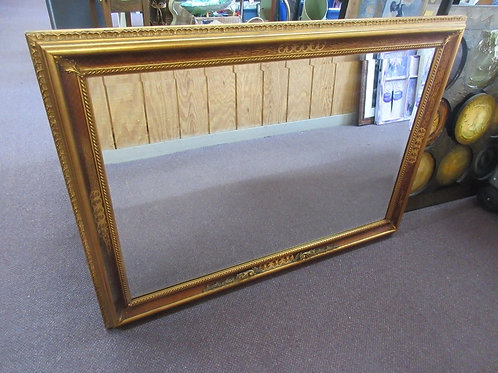 Large heavy beveled mirror in ornate gold frame25x39""