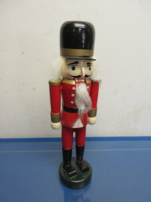"""Red nutcracker with black hat 12"""" high"""