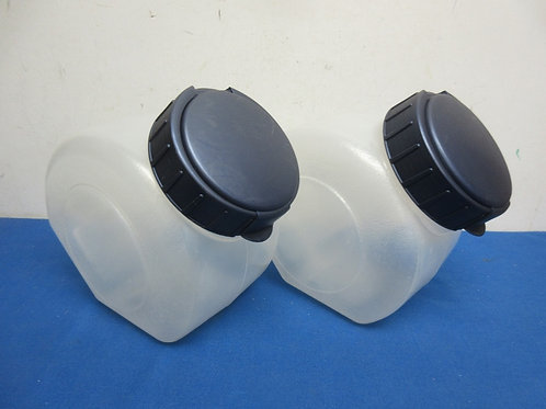 Pair of plastic tilted canisters with blue lids