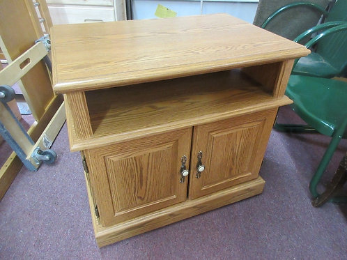 Light tone oak microwave stand on wheels-has shelf and 2 doors, could be used fo
