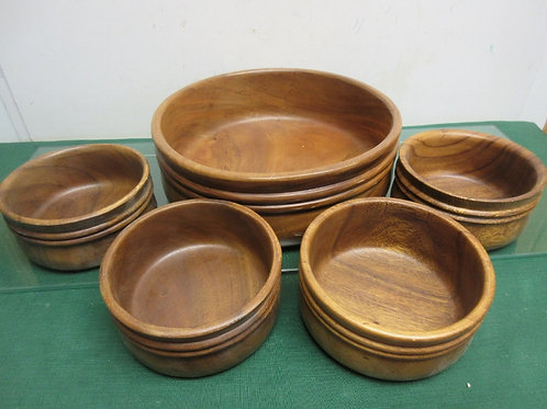 Set of 4 wooden salad bowls and large wooden serving bowl