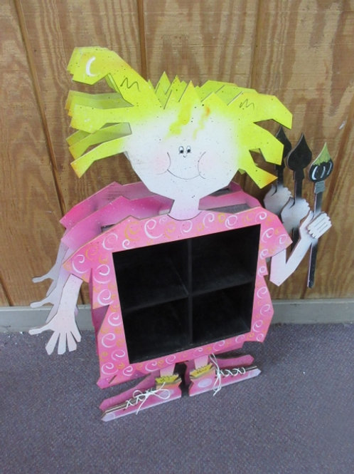 Small 4 cubby shelf - the frame is dimensional - blonde gril holding a paint bru