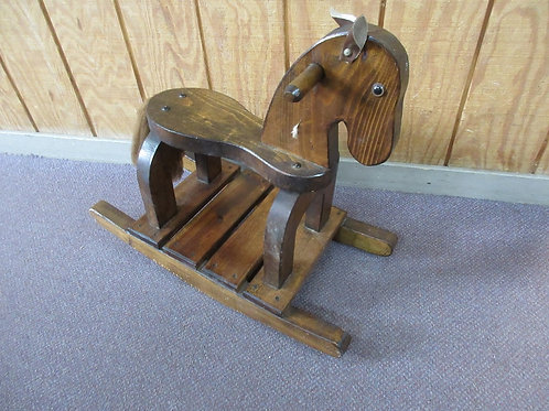 Solid wood childrens rocking horse