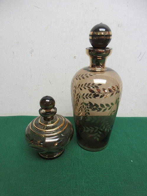"""Pair of brown glass decorative jars 4"""" and 9"""" tall"""