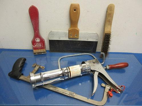 Assorted tools - caulking gun, hacksaw, coping saw, steel brush & more