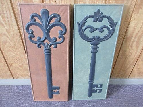 """Pair of metal dimensional """"Key"""" wall hangings, one green, one orange, 13x34"""""""