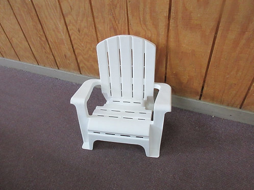 Childs white plastic chair with arms