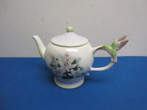 Tea pot with hummingbird on the handle