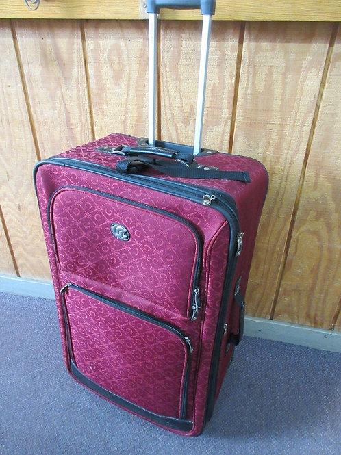 Oleg Cassini large burgundy suitcase on wheels with pull up handle